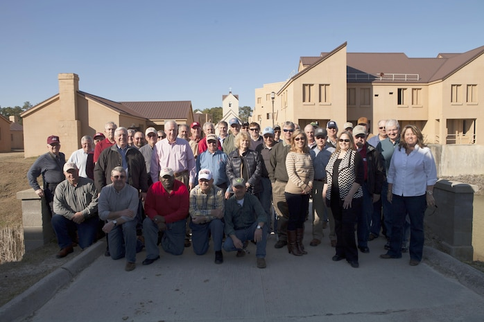 State board members of the Farm Bereau Association pose for a group photo during their tour of the Military Operations on Urban Terrain site, aboard Marine Corps Base Camp Lejeune, Feb. 24. The puprose of the visit was to gain a better understanding of the Marine Corps in hopes of forming a charitable partnership.