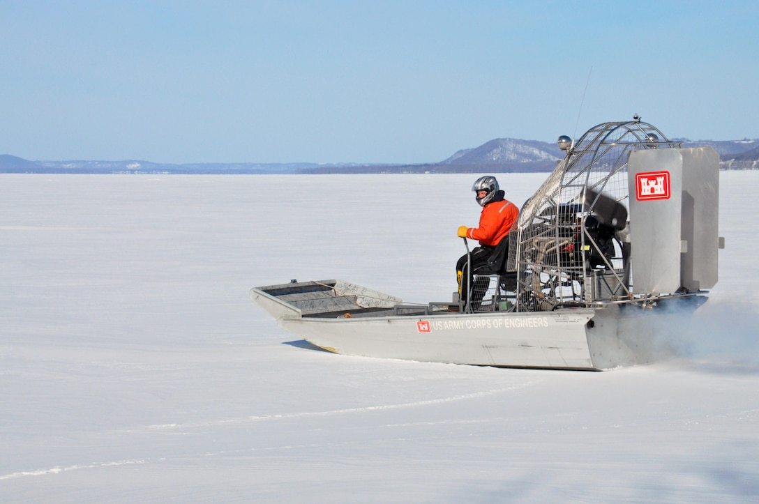 RED WING, Minn. – Al VanGuilder, St. Paul District lead survey technician, launches the St. Paul District airboat on to the Mississippi River, near Lake City, Minn., Feb. 27, to begin measuring the ice thickness within Lake Pepin. The Corps of Engineers measures the ice thickness every spring and the navigation industry uses the information to determine when to break through the ice and begin the shipping season. Lake Pepin ice is traditionally the last hurdle for the navigation industry to deal with before reaching St. Paul, because the ice is usually a lot thicker in the lake due to the slow moving current.