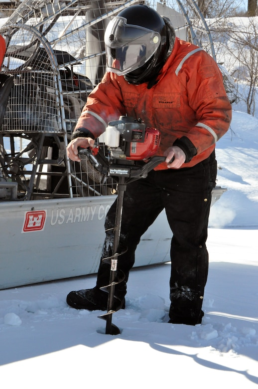 RED WING, Minn. – Bill Chelmowski, St. Paul District small boat operation and ice survey technician, prepares to drill a hole in the Mississippi River, near Lake City, Minn., Feb. 27, to measure the ice thickness within Lake Pepin. The Corps of Engineers measures the ice thickness every spring and the navigation industry uses the information to determine when to break through the ice and begin the shipping season. Lake Pepin ice is traditionally the last hurdle for the navigation industry to deal with before reaching St. Paul, because the ice is usually a lot thicker in the lake due to the slow moving current.