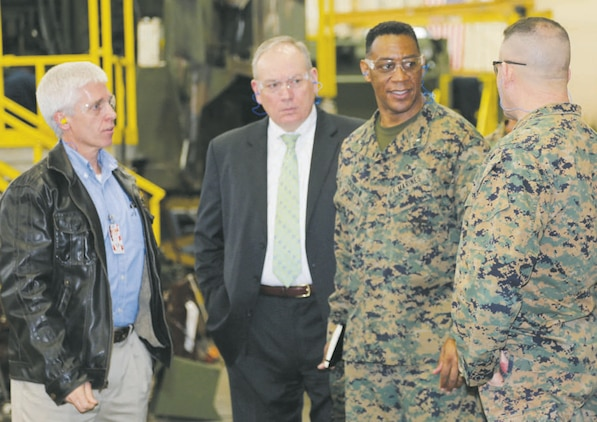 Brig. Gen. Craig C. Crenshaw, (center) assistant deputy commandant for Installations and Logistics (Plans), speaks to Col. Jeffrey Hooks, commander, Marine Depot Maintenance Command, during a recent tour of Production Plant Albany, while Darren Jones, (left) plant manager, PPA, and Michael Madden, executive deputy, Marine Corps Logistics Command, listen.