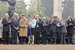 Distinguished guests applaud for U.S. Medal of Honor recipient and D-Day veteran Walter Ehlers during the 63rd Anniversary of D-Day in Normandy, France, June 6, 2007.