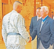 Then-Maj. Gen. Vincent K. Brooks, 1st Inf. Div. and Fort Riley commanding general, welcomes Walter D. Ehlers to Fort Riley during a 2009 visit.  Ehlers passed away at the age of 92 on Feb. 20, 2014, in Long Beach, Calif.