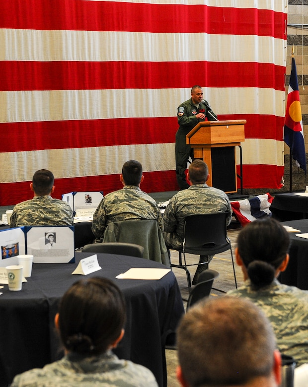 Col. Floyd Dunstan, 140th Wing commander, addresses base and community members at the monthly Aurora Defense Council meeting Feb. 27, 2014, at the Navy Operational Support Center Denver facility on Buckley Air Force Base, Colo.  The meeting included a briefing from base partner commanders, local and state organizations, and an unmanned aerial vehicle demonstration by Falcon UAV. (U.S. Air Force photo by Senior Airman Phillip Houk/Released)