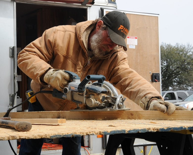 Jim Parker, local contractor, cuts a piece of wood to be used with the installation a window in a dormitory on Barksdale Air Force Base, La., Feb. 25, 2014. The 2nd Civil Engineer Squadron Dorm Management office is in the process of renovating various dorms on Barksdale as a way to promote a better quality of life for Airmen.  (U.S. Air Force photo/Staff Sgt. Sean Martin)