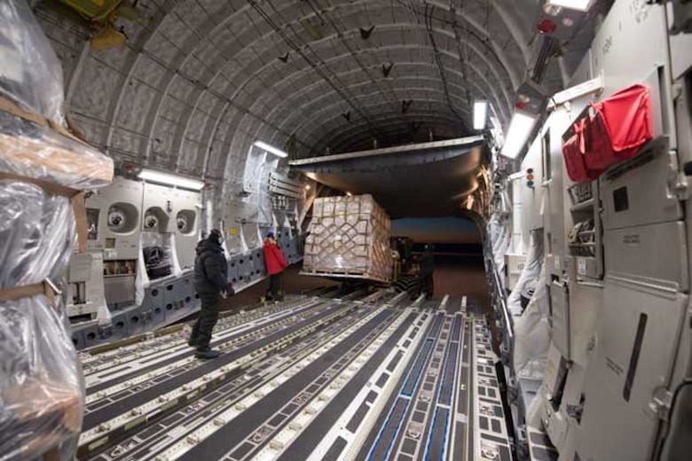 Cargo is unloaded from a McChord C-17at McMurdo Station, Antarctica  (Courtesy photo by Alasdair Turner)