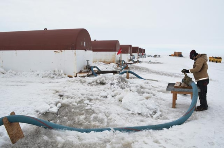 Dirty snow can be seen around the fuel pits at Pegasus Airfield. A wind storm from Black Island in December deposited a layer of dark mineral dust at the airfield and adjoining snow roads, causing serious melt issues that disrupted transportation through early February. (Courtesty photo by Peter Rejcek, Antarctic Sun Editor)