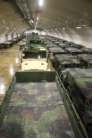 Medium Tactical Vehicle Replacements, High Mobility Multipurpose Wheeled Vehicles and trailers, which belong to Marine Corps Prepositioning Program - Norway are staged in a storage cave at Tromsdal, Norway, Feb. 24, 2014. Marine Corps began storing equipment in several cave sites throughout Norway in the 1980s to counter the Soviets, but the gear is now reserved for any time of crisis or war.