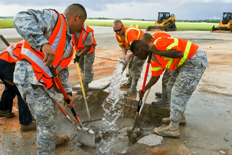 36th Civil Engineer Squadron Airmen mix water and a low-strength concrete together during airfield damage repair training exercise Jan. 23, 2014, at Andersen Air Force Base, Guam. The 36th Civil Engineer Squadron was one of the first units in the Air Force to receive training on a new airfield damage repair capability. (U.S. Air Force photo/Airman 1st Class Emily A. Bradley)