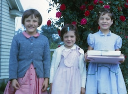 """At 7-years-old, Mary Beth Taliaserro, Betty Grey Waring and Nancy Little, birthday girl, enjoy a Kodak moment. Little, an attorney at the firm of McGuireWoods LLP in Richmond, Va., is not a bit surprised that her childhood buddy, Betty Grey, is a highly successful engineer in the Army Corps of Engineers. """"We played together as children, were in grade school and high school together and have remained friends all these years. Always polite, gracious and determined, Betty Grey exudes calm leadership,"""" Little said."""