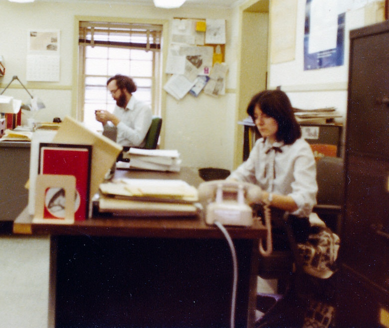 In 1980, Betty Grey Waring, environmental engineer, and her colleague, Richard Klein, civil engineer, work together in the Dredging Management Branch, housed on the second floor of the old Fort Norfolk barracks building 2. Foundation construction for their new headquarters, the Waterfield Building, had just begun.