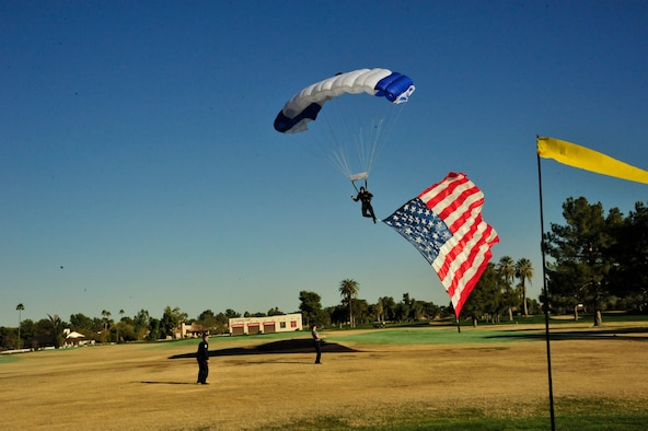 An Air Force Wings of Blue member makes an approach to land Dec. 27, 2013, at the Wigwam Resort and Spa in Litchfield Park. Wings of Blue members do roughly 19,000 jumps a year for the Air Force basic free-falling course AM490 and training. (U.S. Air Force photo/Senior Airman Grace Lee)