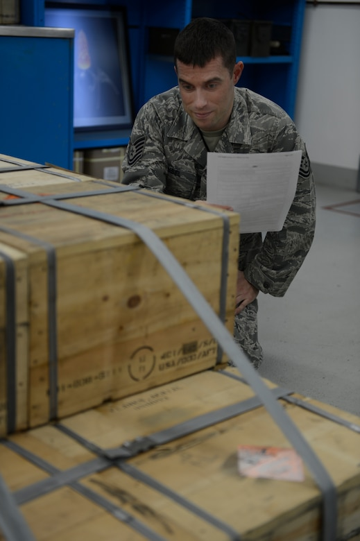 U.S. Air Force Tech. Sgt. Nathan Ansel, 52nd Equipment Maintenance Squadron senior munitions inspector from Ephrata, Pa., inspects crates of aircraft counter measure flares Feb. 26, 2014 on Spangdahlem Air Base, Germany. Munitions are inspected to insure that they are serviceable and ready to use on an aircraft. (U.S. Air Force photo by Staff Sgt. Christopher Ruano/Released)