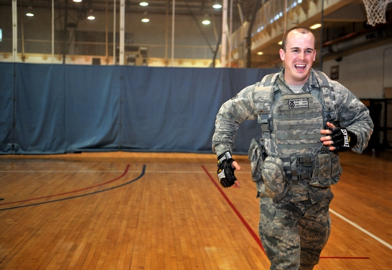 Staff Sgt. Joseph Kaczynski, a member of the 51st Security Forces Squadron, runs sprints during a House of Pain training event in the fitness center at Osan Air Base, Republic of Korea, Feb. 27, 2014. House of Pain mimics training used by the U.S. Marine Corps and completion is mandatory for all 51st SFS personnel. (U.S. Air Force photo/Airman 1st Class Ashley J. Thum)