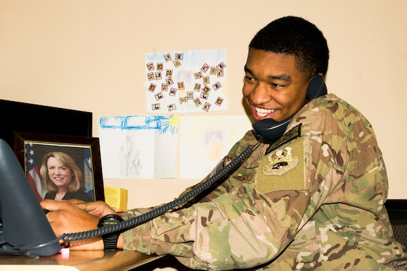 Senior Airman Matthew Rice receives a phone call from Secretary of the Air Force Deborah Lee James, Dec. 31, 2013 at Bagram Airfield, Afghanistan. The secretary called to wish deployed Airmen a happy new year and let them know the Air Force leadership team was thinking about them and their families. Rice is a native of Altus, Okla. (U.S. Air Force photo by Staff Sgt. Ariel Hunsuckle)