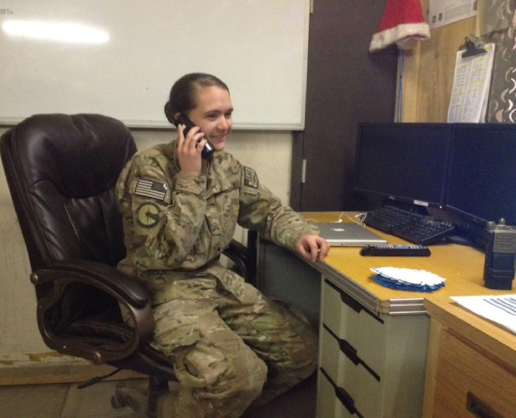 Airman 1st Class Ashli Six receives a phone call from Secretary of the Air Force Deborah Lee James, Dec. 31, 2013 at Bagram Airfield, Afghanistan. The secretary called to wish deployed Airmen a happy new year and let them know the Air Force leadership team was thinking about them and their families. Six is a native of Green, Ohio. (Courtesy Photo)