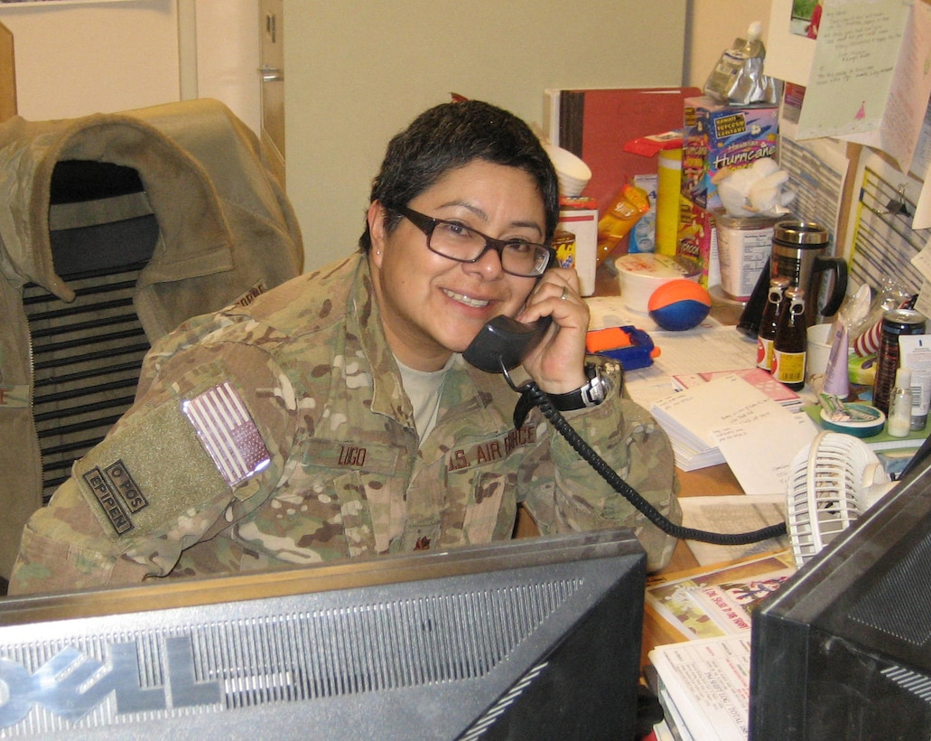 Maj. Carla Lugo receives a phone call from Secretary of the Air Force Deborah Lee James, Dec. 31, 2013 at Bagram Airfield, Afghanistan. The secretary called to wish deployed Airmen a happy new year and let them know the Air Force leadership team was thinking about them and their families. Lugo is a native of Flagstaff, Ariz. (Courtesy Photo)