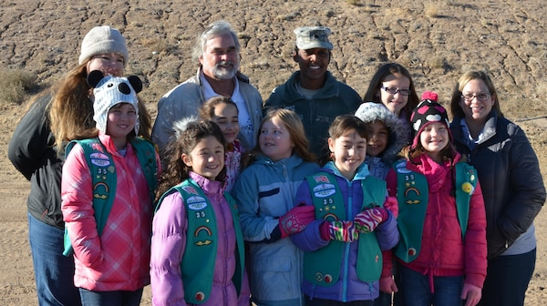 ALBUQUERQUE, N.M., -- Kurt Wagener, field engineer for the Albuquerque Metropolitan Arroyo Flood Control Authority, back row second from left; Lt. Col. Antoinette Gant, commander, US Army Corps of Engineers, Albuquerque District; and Girl Scout Troop #35, New Mexico, pose for a photo, Dec. 14, 2013, at the Calabacillas Arroyo prior to working on the owl habitat.