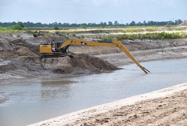 A contractor works in the intake canal as part of the C-44 Reservoir and Stormwater Treatment Area project near Indiantown in Martin County, Fla. The Jacksonville District Construction Division placed $385 million of work during Fiscal Year 2013, and leaders expect a bigger year in 2014.