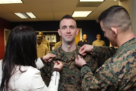 Staff Sgt. John B. York, canvassing recruiter, Recruiting Substation Monroe, is meritoriously promoted to his current rank here Jan. 3. York enlisted in the Marine Corps in April 2005. (Marine Corps photo by Sgt. Aaron Rooks)