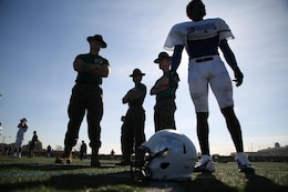 Marine Corps drill instructors from Marine Corps Recruit Depot San Diego engage East Team's well-rounded student athletes from around the nation at Fullerton College in Fullerton, Calif., on Jan. 1, 2014, during practice for the Semper Fidelis All-American Bowl. The bowl brings selected players together with Marines and football coaches to develop skills not only important to football, but throughout life, such as leadership, self-confidence and teamwork. The SFAAB is scheduled for Jan. 5, 2014, at The StubHub Center in Carson, Calif., and will be aired on Fox Sports 1 Network and airs live game day from 6 – 8 p.m. PST/ 9:30 – 11:00 p.m. EST.