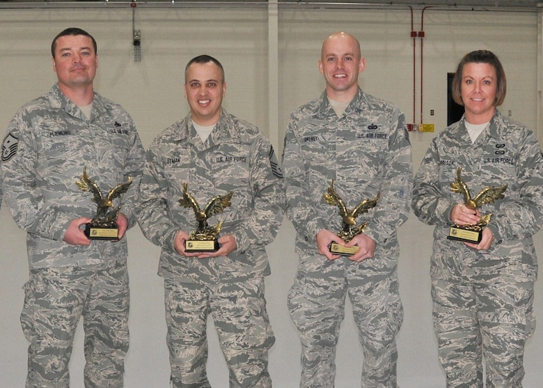 The Missouri Air National Guard named selected Citizen Airmen of the 131st Bomb Wing as their Outstanding Airmen of the Year awardees this month at the Missouri National Guard's headquarters at Ike Skelton Training Site in Jefferson City.  Pictured (center l to r): Master Sgt. Frank Pliemling, Senior Master Sgt. Nicholas Eyman, Staff Sgt. Tyler Owenby. Senior Airman Ashlea Garrison (131st Bomb Wing File Photo)