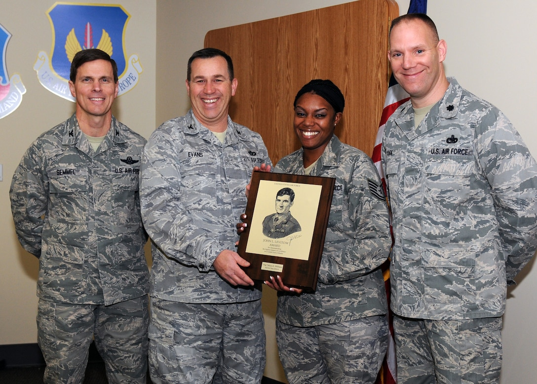 Tech. Sgt. Takeya Williams, presented the  John Levitow award by Colonel Greg Semmel, Colonel Earl Evans & Lt. Colonel Edward Cook for demonstrating the highest degree of excellence as a leader and scholar on Jan 4, 2014. Williams was nominated by her peers for the Levitow award. (Photo by New York Air National Guard Tech. Sgt. Justin A. Huett)