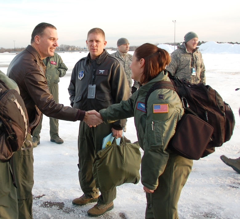 Col. Frank Detorie, commander of the 103rd Airlift Wing, greets Capt. Rachel Leimbach, a navigator assigned to the 139th Airlift Squadron, moments before the launch of the first locally-generated sortie aboard a C-130H Hercules aircraft Dec. 19, 2013, at Bradley Air National Guard Base, East Granby, Conn. The aircrew was comprised of Airmen from the Connecticut Air National Guard, the New York Air National Guard and the U.S.A.F.    (U.S. Air National Guard photo by Maj. Bryon Turner)