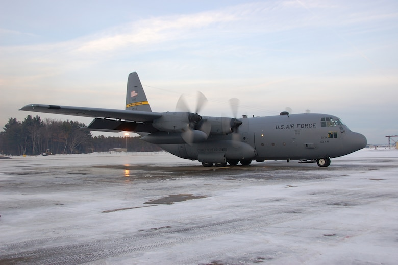 Aircrew aboard a C-130H Hercules aircraft assigned to the 103rd Airlift Wing prepare to taxi moments before conducting the first locally-generated sortie with the unit's new airframe at Bradley Air National Guard Base, East Granby, Conn., Dec. 19, 2013.  (U.S. Air National Guard photo by Maj. Bryon Turner)