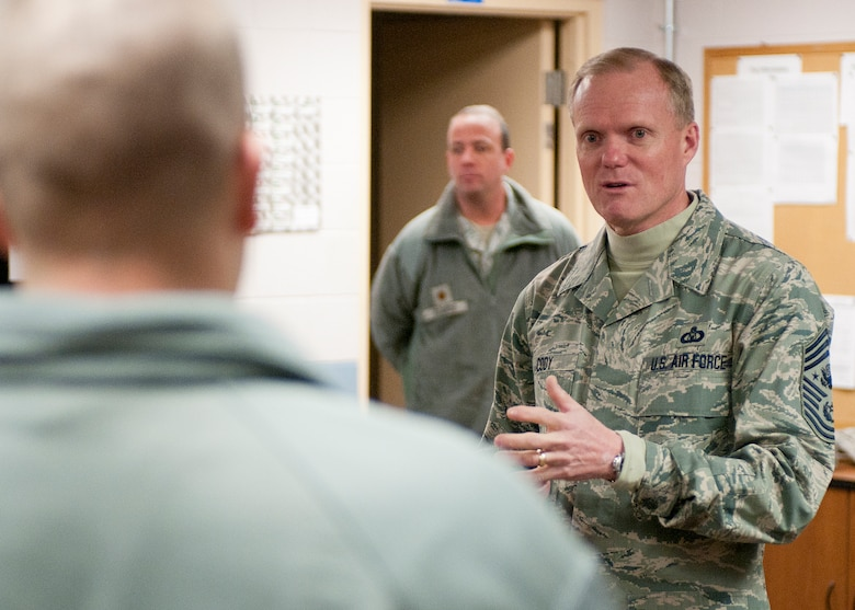 PEASE AIR NATIONAL GUARD BASE, N.H. -- Chief Master Sgt. of the Air Force James Cody speaks with members of the 157th Air Refueling Wing prior to a call for junior enlisted members in Building 253 here Jan. 4. The Air Force's most senior enlisted member visited Pease to meet Airmen and answer their questions.. Prior to the junior enlisted all-call, CMSAF Cody presented coins to six Airmen from across the wing for outstanding contributions in 2013. (N.H. Air National Guard photo by Tech. Sgt. Mark Wyatt/Released)