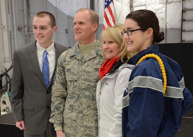 PEASE AIR NATIONAL GUARD BASE, N.H. -- Billy Toth, Chief Master Sgt. of the Air Force James Cody, Athena Cody, Ashlyn Correia (left to right) pose for a picture Jan. 4, 2014 on Pease Air National Guard Base, Portsmouth N.H. The Air Force's most senior enlisted member visited Pease ANGB to speak with enlisted Airmen and observe the unique capability they provide to the state of New Hampshire and the Air Force. (N.H. National Guard photo by Airman 1st Class Kayla M. McWalter/Released)