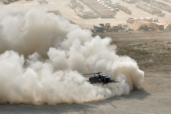 An HH-60G Pave Hawk helicopter assigned to the 33rd Expeditionary Rescue Squadron performs a brown out landing Sept. 24, 2010, at Bagram Airfield, Afghanistan. (U.S. Air Force photo)
