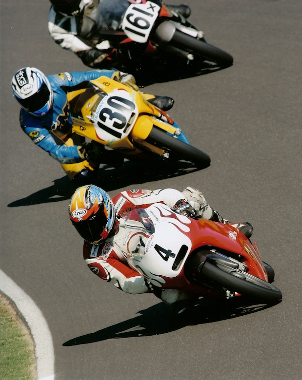 Lt. Col. Stewart Aitken-Cade, Aerospace Data Facility-Colorado, speeds past competitors during a motorcycle race. Aitken-Cade has been riding motorcycles for nearly two decades and has won four national championships. (Courtesy Photo)