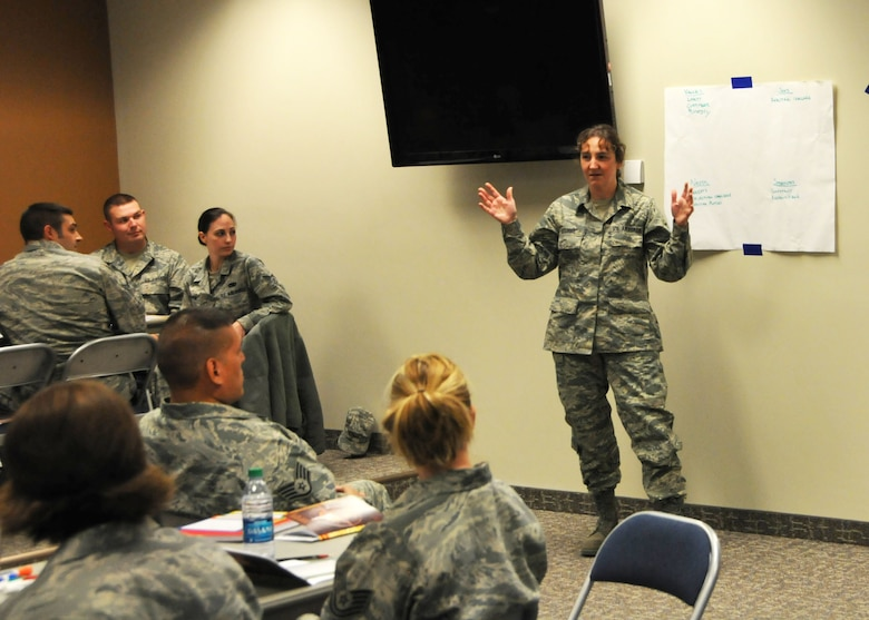Master Sgt. Christina Hutchins discusses a small-group project during the communication training exercise at the enlisted continuing process improvement event held at the 120th Fighter Wing in Great Falls, Mont. on Nov. 2, 2013. National Guard photo/Tech. Sgt. Christy Mason.