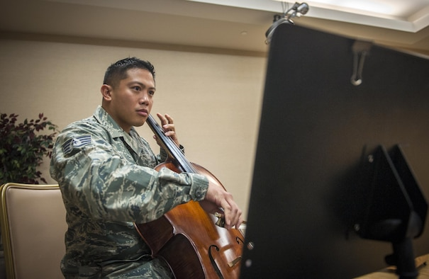 Staff Sgt. Joey Lee plays the national anthem on his cello Sept. 6, 2013, at Moody Air Force Base, Ga. He started playing the cello when he was 9 years old. Lee is a 23rd Aerospace Medicine Squadron public health technician. (U.S. Air Force photo/Senior Airman Jarrod Grammel)