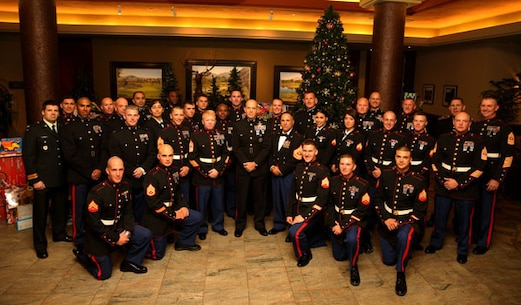 Maj. Gen. David H. Berger, MCAGCC commanding general, center, poses with Marines and a sailor at the PGA West clubhouse in La Quinta after a Toys for Tots dinner hosted by club members.