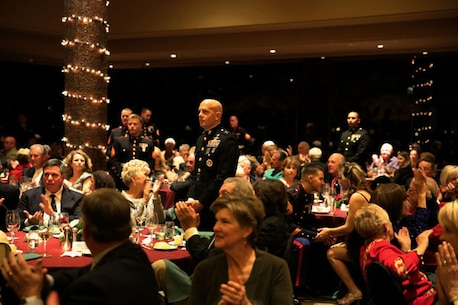 Maj. Gen. David H. Berger, MCAGCC commanding general, center, and other service members receive applause during a Professional Golf Association West dinner at the PGA West clubhouse in La Quinta.