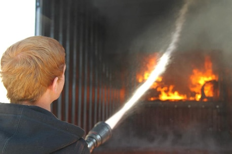 A Morongo Basin-area high school student learns the art of fighting fires during a Job Shadow visit. The program pairs local students with Marines, sailors and civilian employees who work in their field of interest.