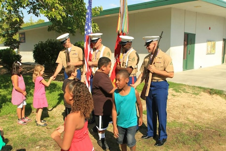 Marines from 1st Tank Battalion shake hands with students after a 9/11 memorial service at Palm Vista Elementary School in Twentynine Palms.