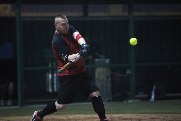 Michael Malone, first baseman, Marine Corps Forces Central Command Forward Team #2 hits the first home run of the season in the third inning of the 2012 Naval Support Activity Bahrain American Softball League season opener, July 15.