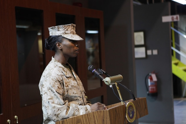 Maj. Melanie R. Bell-Carter, of Cleveland Miss., gives her parting remarks as the commanding officer of Headquarters Company, United States Marine Corps Forces Central Command (Forward).  Bell-Carter was replaced by Maj. Sally A. Falco, a Detroit native, Aug. 15 in a change of a command ceremony.