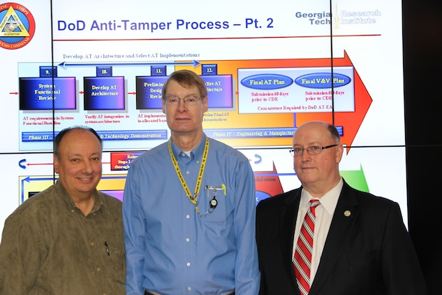 Mike O'Neal (left), modeling and simulation team lead; Joseph Sauer (center), senior research engineer at the Georgia Tech Research Institute Quantico Field Office; and Dave Matthews, Technology Protection Branch chief, are creating a software program to support anti-tampering efforts at Marine Corps Systems Command for the rest of the Corps.
