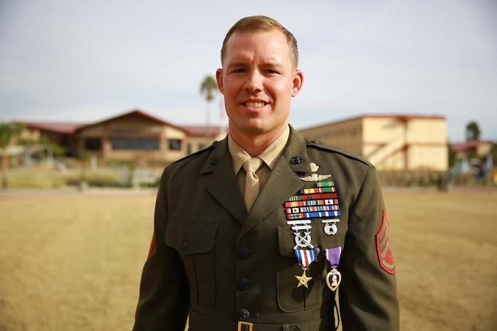 Staff Sgt. Timothy Williams, a section leader with 1st Reconassiance Battalion, recieves the Silver Star Medal and Purple Heart from Lt. Gen. John Toolan, commanding general of I Marine Expeditionary Force, during an award ceremony held at Camp Las Flores, Marine Corps Base Camp Pendleton, Calif., Jan. 7, 2014. Williams, a native of Hudson, Mich., was recognized for his heroic actions in Afghanistan when he maintained a tactical advantage while being ambushed by a larger enemy force. Williams helped save the lives of multiple Marines and destroyed several enemy positions during the 10 hour attack. (U.S Marine Corps photo by Lance Cpl. Jonathan Boynes/released)