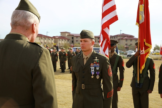 Staff Sgt. Timothy Williams, a section leader with 1st Reconnaissance Battalion, receives the Silver Star Medal and Purple Heart from Lt. Gen. John Toolan, commanding general of I Marine Expeditionary Force, during an award ceremony held at Camp Las Flores, Marine Corps Base Camp Pendleton, Calif., Jan. 7, 2014. Williams, a native of Hudson, Mich., was recognized for his heroic actions in Afghanistan when he maintained a tactical advantage while being ambushed by a larger enemy force. Williams helped save the lives of multiple Marines and destroyed several enemy positions during the 10 hour attack. (U.S Marine Corps photo by Lance Cpl. Jonathan Boynes/released)