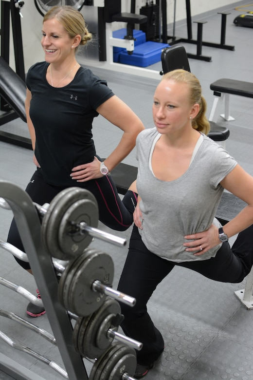 Tech. Sgt. Melanie McDonald, left, and 1st Lt. Angie Hellenbrand, members of the 115th Fighter Wing Fitness Working Group, work out together at the base gym on Truax Field in Madison, Wis., Jan. 9. As members of the fitness group, Airmen have the opportunity to participate in fitness classes and a running program. (Air National Guard photo by Senior Airman Andrea F. Liechti)