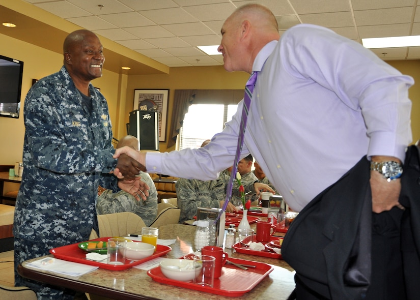 """U.S. Army Col. Thomas Boccardi, Commander, Joint Task Force-Bravo, greets U.S. Navy Capt. Ronnie King, Command Chaplain, U.S. Southern Command, prior to King speaking at a """"Prayer Breakfast"""" sponsored by the Joint Task Force-Bravo Chapel at Soto Cano Air Base, Honduras, Jan. 9, 2013.  As command chaplain, King is responsible for coordinating chaplain support to ensure the free exercise of religion for Army, Navy, Air Force, Marine and Coast Guard service members, their family members and other U.S. personnel within the SOUTHCOM area of responsibility. (U.S. Air Force photo by Capt. Zach Anderson)"""