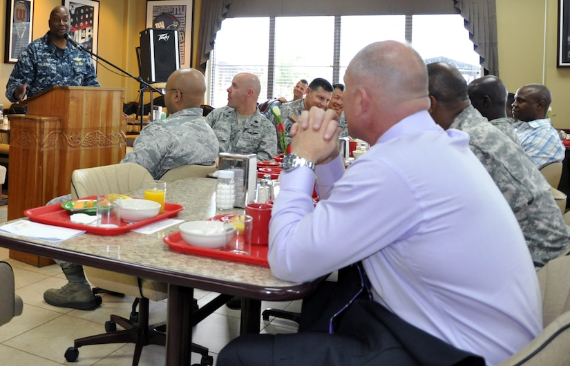"""U.S. Navy Capt. Ronnie King, Command Chaplain, U.S. Southern Command, visited with members of Joint Task Force-Bravo during a """"Prayer Breakfast"""" sponsored by the Joint Task Force-Bravo Chapel, Jan. 9, 2013. As command chaplain, King is responsible for coordinating chaplain support to ensure the free exercise of religion for Army, Navy, Air Force, Marine and Coast Guard service members, their family members and other U.S. personnel within the SOUTHCOM area of responsibility. (U.S. Air Force photo by Capt. Zach Anderson)"""