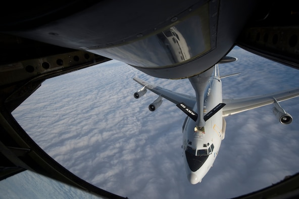 A KC-135 Stratotanker refuels a NATO E-3 Sentry Jan. 7, 2014, over northeast Afghanistan. The crew of the Stratotanker provided fuel for coalition aircraft during the more than 10-hour combat sortie. The KC-135 is assigned to the 340th Expeditionary Air Refueling Squadron in Southwest Asia. (U.S. Air Force photo/Tech. Sgt. Jason Robertson)