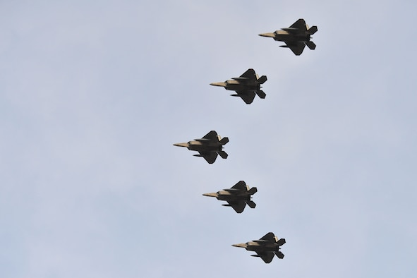 Five F-22 Raptors fly in formation during an event held in their honor Jan. 6, 2014, at Tyndall Air Force Base, Fla. These jets mark the beginning of a new mission at Tyndall AFB and are the first five of 24 marked to call Tyndall AFB their new home. (U.S. Air Force photo/Airman 1st Class Dustin Mullen)