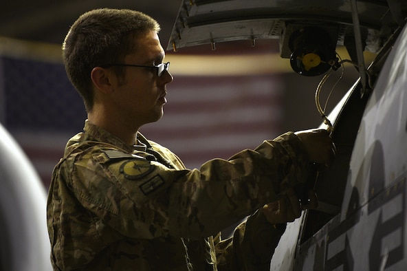 Senior Airman Anthony Green tests the panel fan on an A-10 Thunderbolt II Dec. 30, 2013, at Bagram Airfield, Afghanistan. The A-10 Thunderbolt II provides close-air support for troops on the ground. Green is a 455th Expeditionary Maintenance Squadron electrical environmental journeyman. He is deployed from the 23rd Component Maintenance Squadron at Moody Air Force Base, Ga. (U.S. Air Force photo/Senior Airman Kayla Newman)