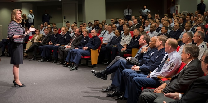 Secretary of the Air Force Deborah Lee James talks to a gathering of uniformed and civilian Airmen during her first town hall meeting Jan. 9, 2014, in the Pentagon auditorium, Washington, D.C. During her address, James spoke about her 32 years of defense experience, passing on the lessons she's learned, and encouraging Airmen to view challenges as opportunities.  (U.S. Air Force photo/Jim Varhegyi)